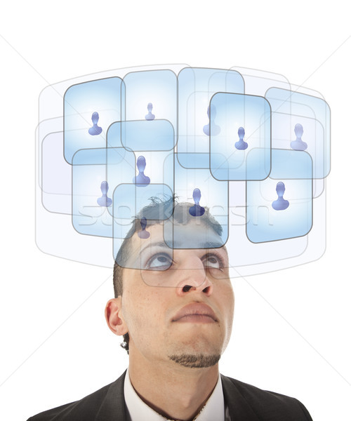 Young man looking at his virtual friends isolated on white Stock photo © gigra