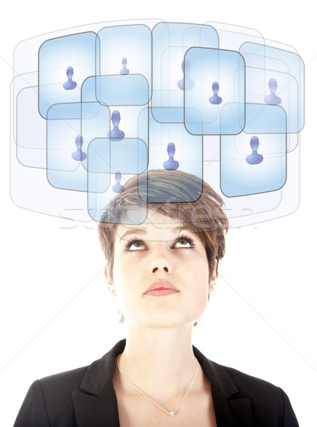 Stock photo: Young woman looking at her virtual friends isolated on white
