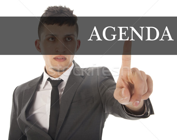 Young businessman with text agenda isolated on white background Stock photo © gigra