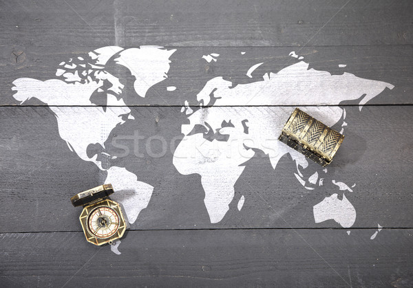 World map with compass and treasure on dark black wooden background Stock photo © gigra