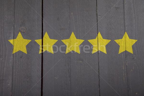 öt citromsárga rangsor csillagok fekete fából készült Stock fotó © gigra