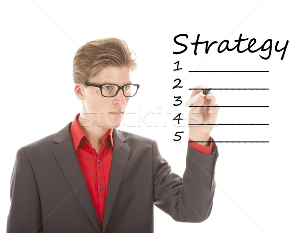 Stock photo: Young man writing strategy on white isolated background