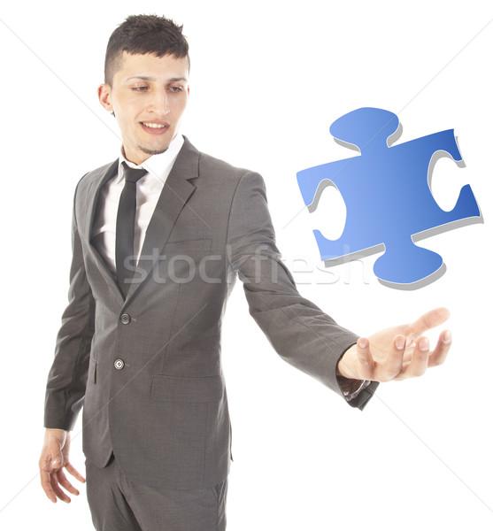 Jeune homme puzzle pièce isolé blanche affaires Photo stock © gigra