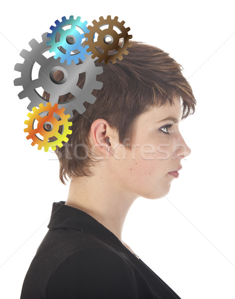 Young woman thinking with gears isolated on white background Stock photo © gigra