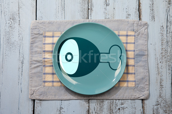 Empty plate with meat icon on light blue wooden background Stock photo © gigra