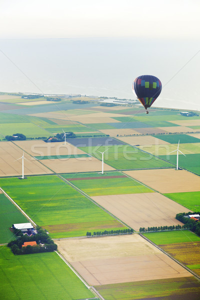 Hot air balloon with Dutch agricultural landscape Stock photo © gigra