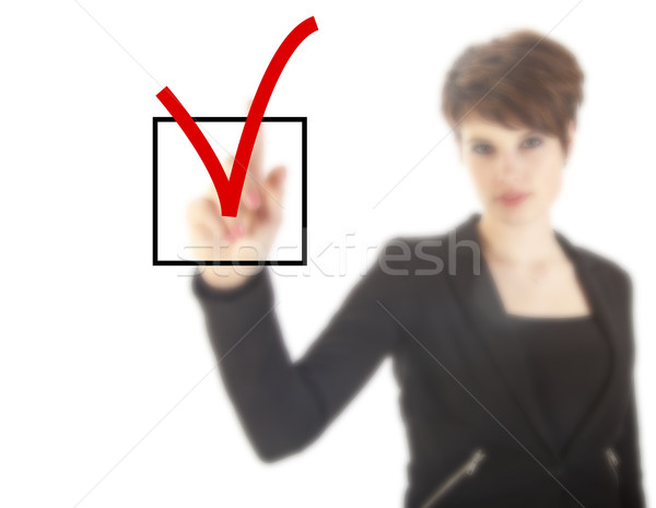 Young woman with checkbox isolated on white background Stock photo © gigra