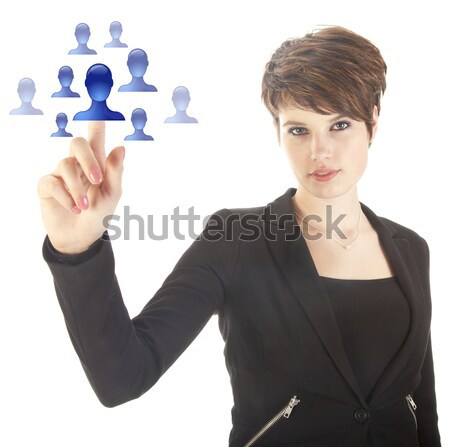 Young man selecting blue virtual friends isolated on white background Stock photo © gigra