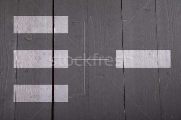 White organigram on dark wooden background Stock photo © gigra