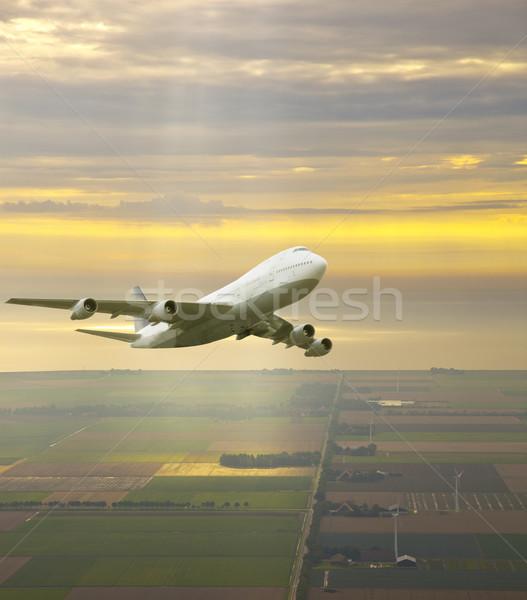 Uçak uçan güzel sarı gökyüzü bulutlar Stok fotoğraf © gigra