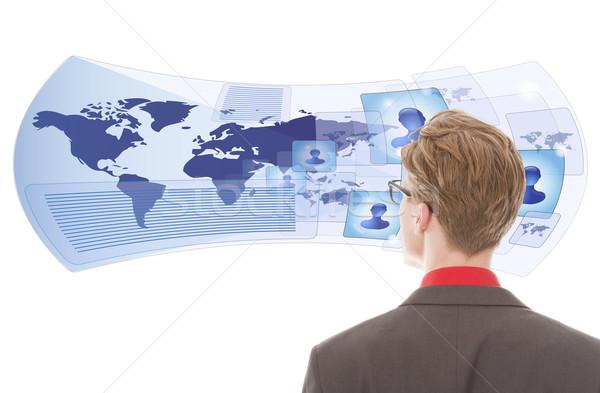 Joven mirando virtual gafas aislado blanco Foto stock © gigra