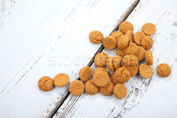 Pile of Dutch candy pepernoot on white wooden background Stock photo © gigra