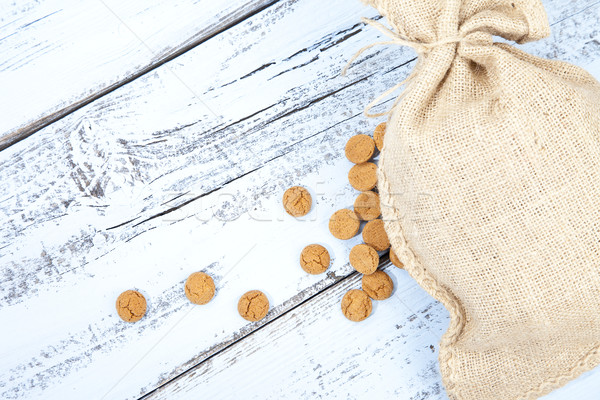 Dutch candy pepernoot with jute bag on white blue wooden background Stock photo © gigra