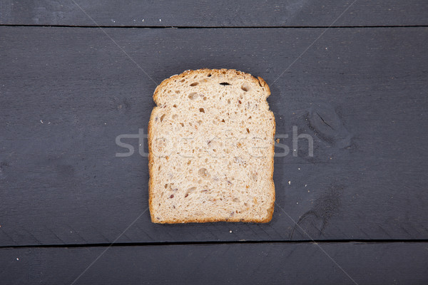 Gluten free bread on black wooden background Stock photo © gigra