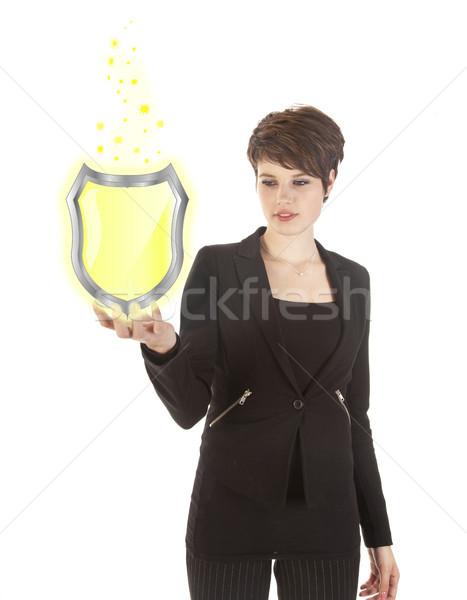 Fiatal nő tart fényes citromsárga pajzs izolált Stock fotó © gigra