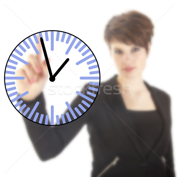 Young businesswoman with clock isolated on white background Stock photo © gigra