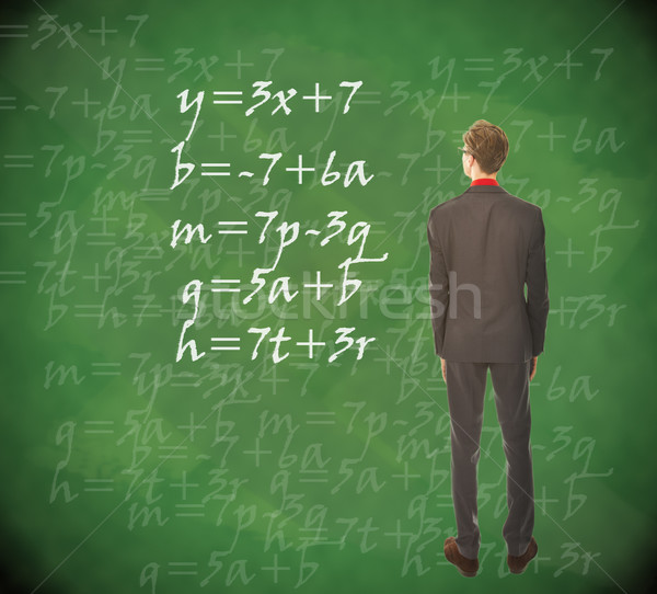 Young student looking at chalkboard with mathematics Stock photo © gigra