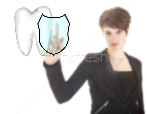 Young woman with tooth shield symbol isolated on white background Stock photo © gigra