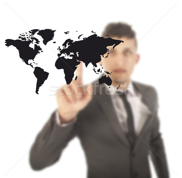 Young man with black world map isolated on white background Stock photo © gigra