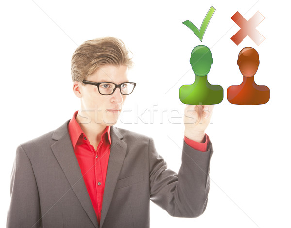 Young man selecting yes or no isolated on white background Stock photo © gigra
