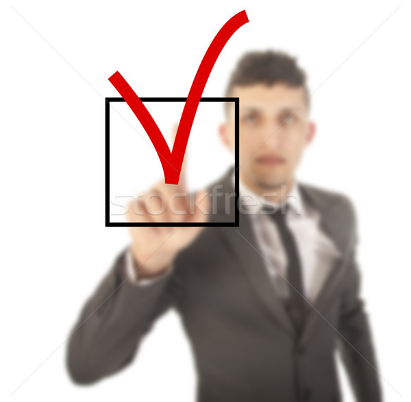 Young businessman with checkbox isolated on white background Stock photo © gigra