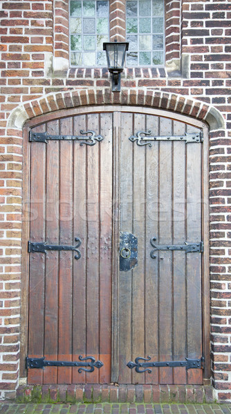 Old wooden door with old lantern and bricks Stock photo © gigra