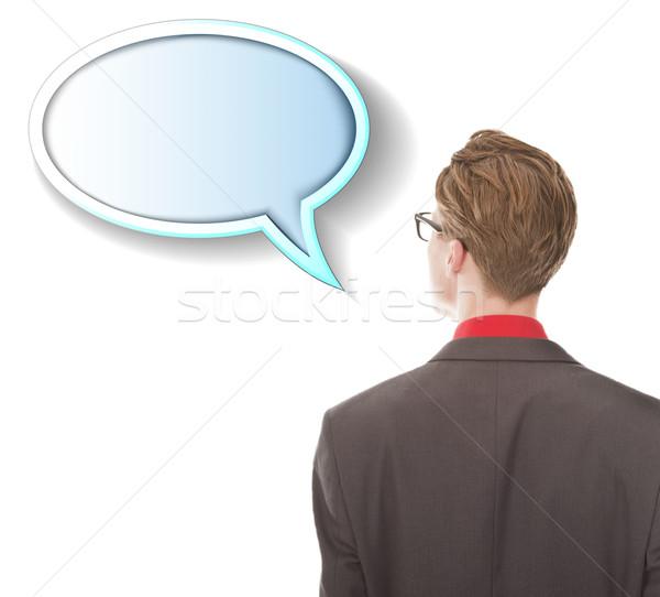 Joven mirando texto globo aislado blanco Foto stock © gigra