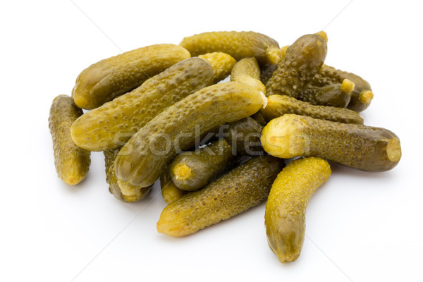 Stock photo: Marinated pickled cucumbers isolated on the white.