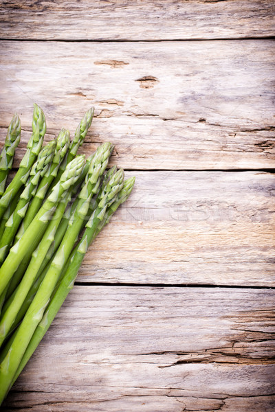 Asparagus on the wooden background. Stock photo © gitusik