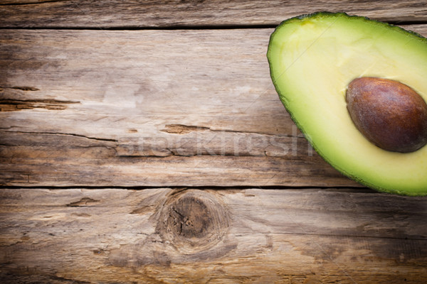 Avokádó alkatrészek fa asztal étel zöld eszik Stock fotó © gitusik