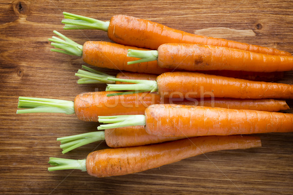 Fresh carrots on the wooden background. Stock photo © gitusik