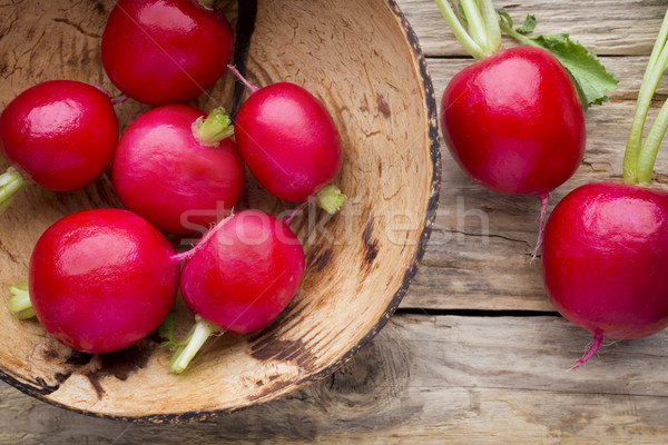 Radish on the wooden table. Stock photo © gitusik