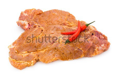 Spicy marinated spare ribs barbecued on the white background. Stock photo © gitusik