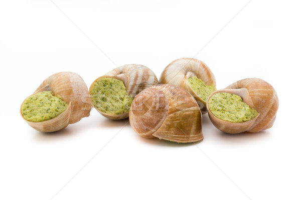 Stock photo: Cooked snails delicacy. French cuisine stuffed snails.