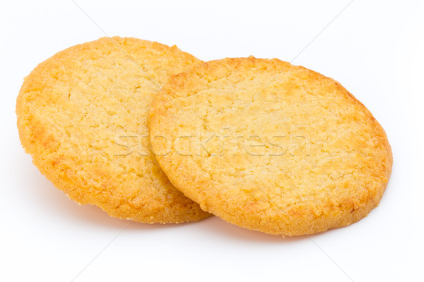Stacked short pastry cookies isolated on white background. Stock photo © gitusik