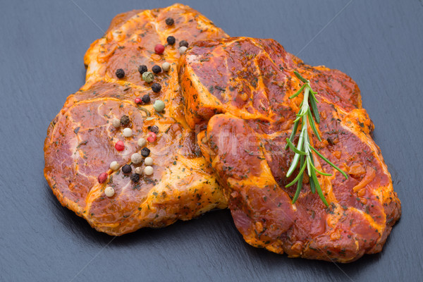 Pork chops, pepper and rosemary marinade. Stock photo © gitusik