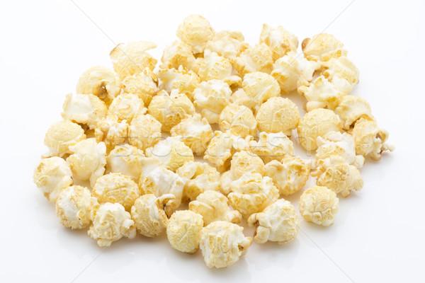 Popcorn isolated on the white background. Stock photo © gitusik