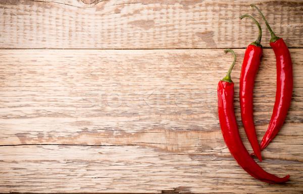 Chilipaprika fából készült természet háttér piros szín Stock fotó © gitusik