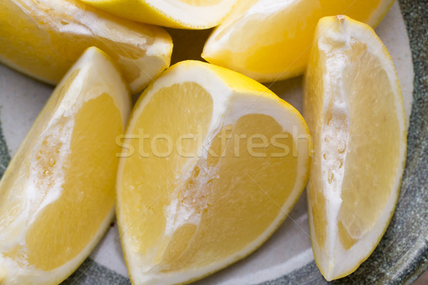 Yellow grapefruit slice on a plate. Stock photo © gitusik