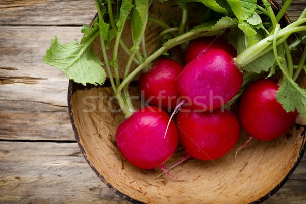 Radish on the wooden table. Stock photo © gitusik