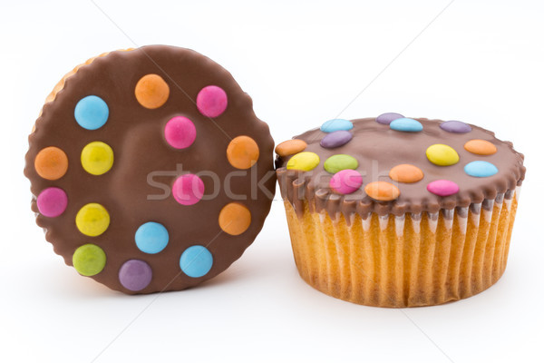Multiple colorful decorated muffins on a white background. Stock photo © gitusik