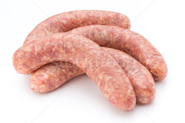 Raw sausage with parsley leaf isolated on white background. Stock photo © gitusik