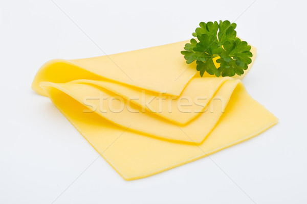 Cheese slices on white background cutout. Stock photo © gitusik