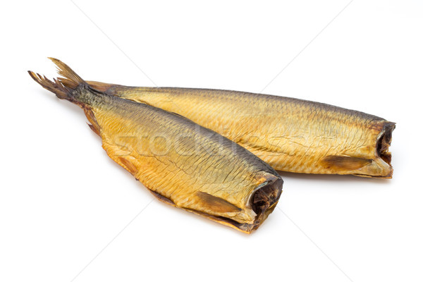 Smoked trout in front of a white background. Stock photo © gitusik