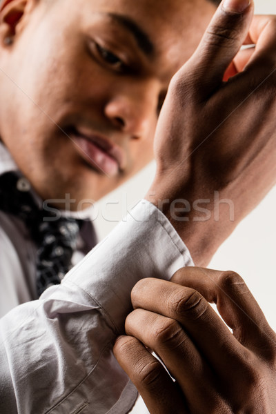 elegant black man adjusting cuff Stock photo © Giulio_Fornasar