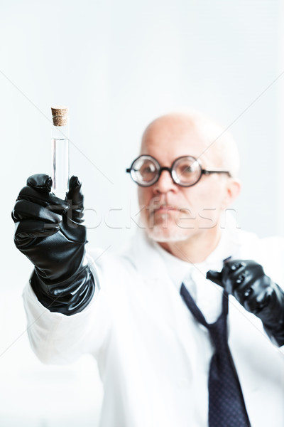 mad scientist watching his malicious potion Stock photo © Giulio_Fornasar
