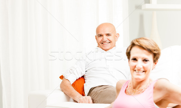 Attractive friendly middle-aged couple Stock photo © Giulio_Fornasar