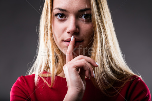 Stock photo: woman with finger on her lips
