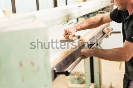hand clamping a wooden board or piece of furniture Stock photo © Giulio_Fornasar