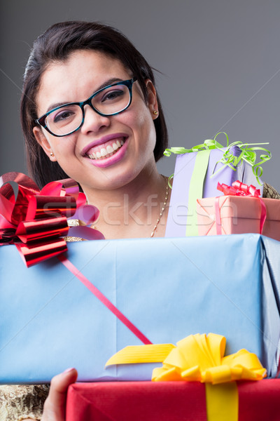 smiling woman with many gifts Stock photo © Giulio_Fornasar